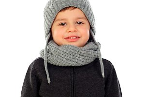 Beautiful child with wool scarf and