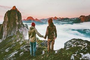 Couple adventurers hands holding
