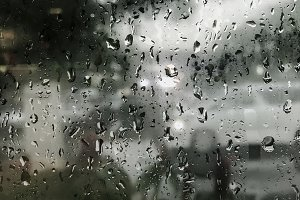 Raindrops on window in rainy day