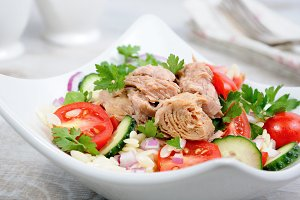 Salad from canned tuna with tomato