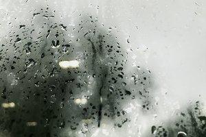 Raindrop on window in rainy day