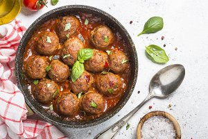 Meatballs in tomato sauce on white