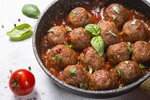 Meatballs in tomato sauce on white