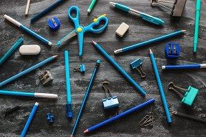 blue school supplies on a blackboard