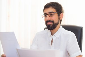 Bearded young man in the office