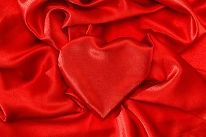 Love concept Heart shaped red silk b