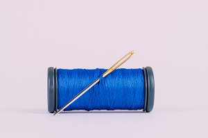 Blue thread with needle