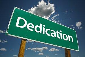 Dedication Green Road Sign