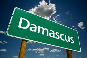 Damascus Green Road Sign Over Sky