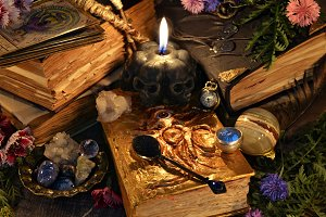 Witch books and skull candle