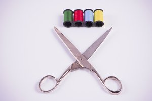 Colored threads with scissors