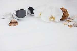 Shells, orchids and sunglasses