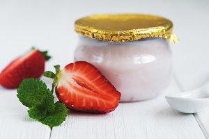 Jar with strawberry yogurt