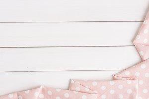 Light pink polka dots folded tablecl