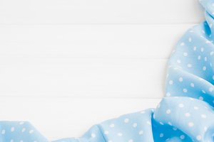 Light blue polka dots folded tablecl