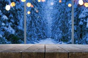 Night winter forest through window
