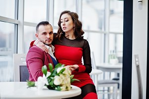 Couple in red love each other at res