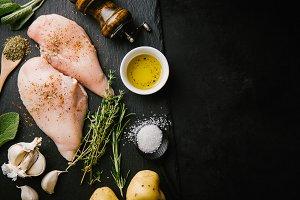 Raw chicken breast on dark backgroun