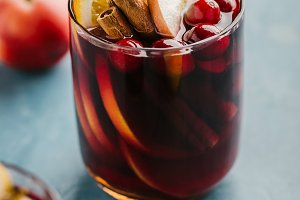 Mulled wine in glass on blue table