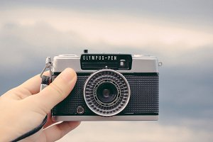 Hand holding analog camera