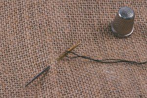 Needle, thread and thimble with sack
