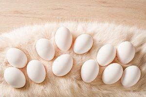 White easter eggs on fur