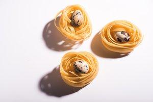 Three italian pasta nests isolated o