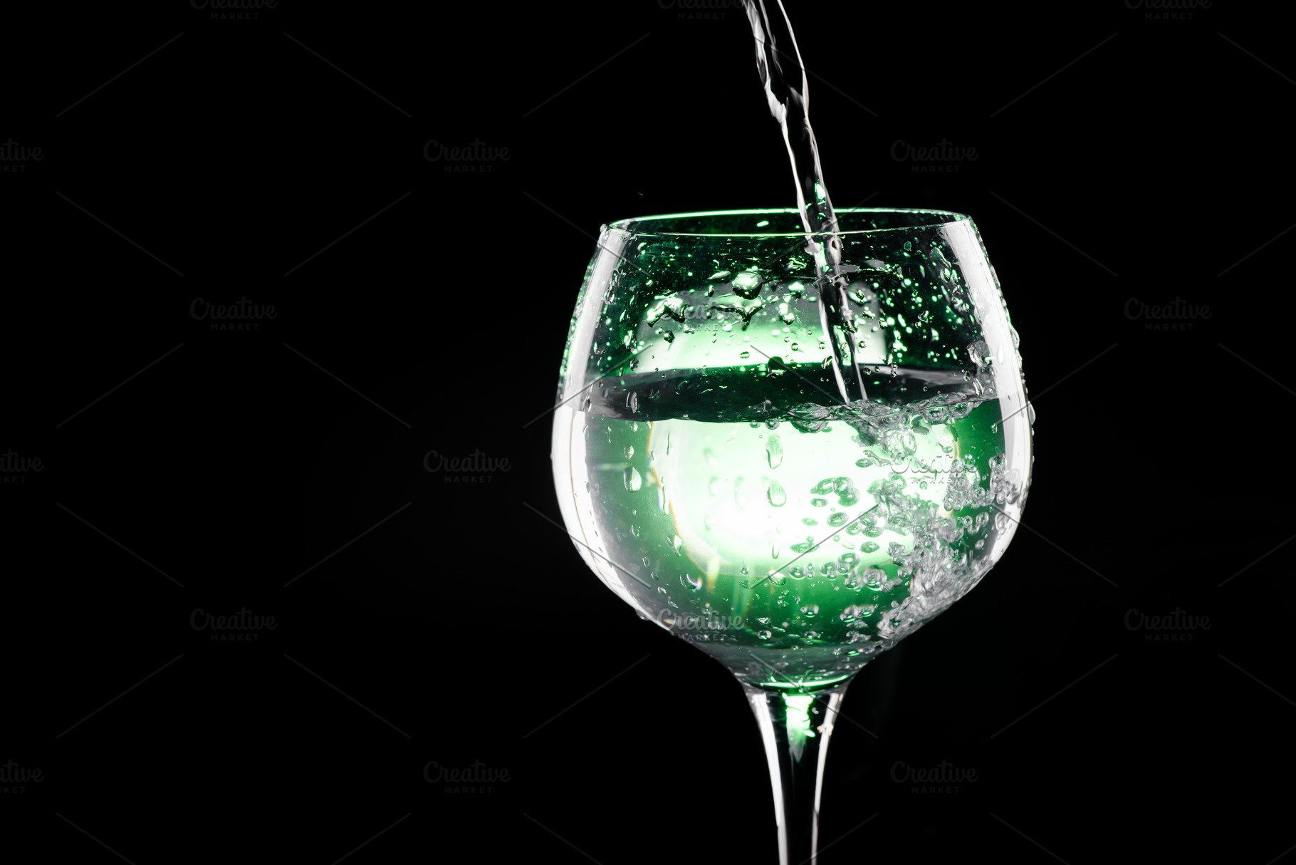 Pouring Water In The Wine Glass With