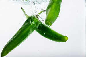 Three jalapeno peppers on white back