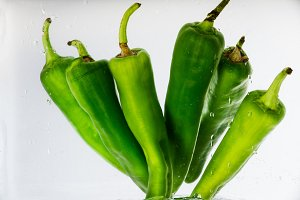 Five jalapeno peppers on white backg
