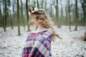 Curly cute blonde girl with wreath i