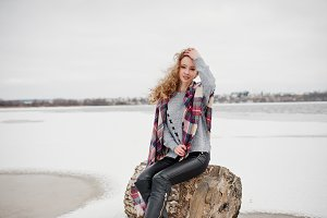 Curly blonde girl in checkered plaid