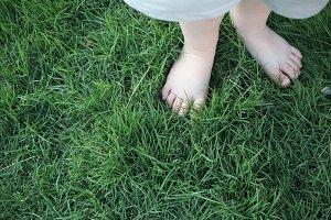 Boy's feet in some lush grass