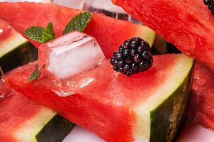 Sliced watermelon with blackberries