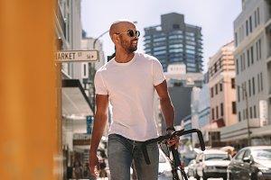 Handsome man in casuals walking