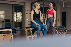 Pilates woman at a gym talking