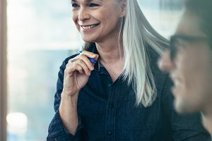 Happy business woman in meeting