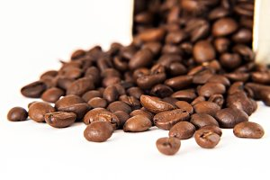 Coffee beans are scattered from stai
