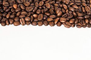 background of coffee beans on a whit