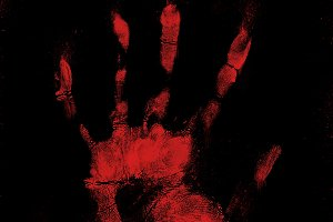 Scary bloody hand print on black