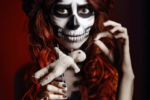 Young woman with muertos makeup