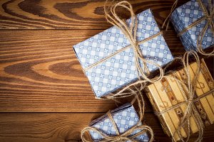 Gift boxes in blue paper on the wood
