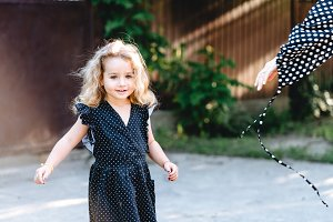 Little girl with curly hair posing a
