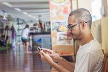Asian man using smartphone