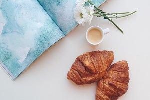 Romantic coffee break with croissant