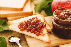 Apple jam on toast and in jar