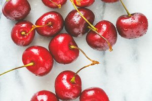 Ripe cherry on a white marble.