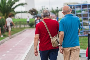 gay couple walking away together on