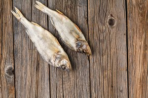 close-up dried fish on a dark wooden