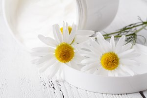 Moisturizing cream and camomile